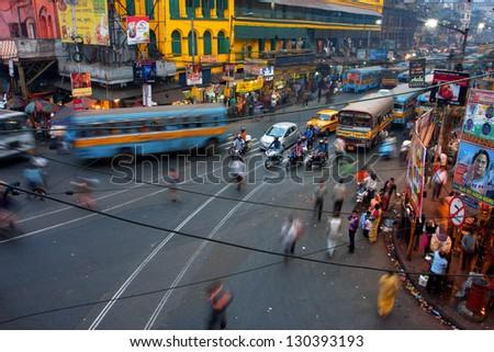 KOLKATA, INDIA - JAN 17: Street traffic blurred in motion at evening on January 17, 2013 in Kolkata, India. Kolkata has a density of 814.80 vehicles per km road length - stock photo