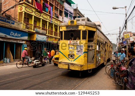 KOLKATA, INDIA - JAN 15: Traditional tram downtown Kolkata at the bright day on December 29, 2008. Kolkata is the only Indian city with a tram network, which is operated by the Calcutta Tramways Comp. - stock photo