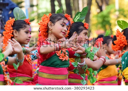 KOLKATA , INDIA - MARCH 5, 2015 : Girl child dancers performing at Holi / Spring festival, known as Dol (in Bengali) or Holi (in Hindi) celebrating arrival of Spring in India. A big popular festival. - stock photo