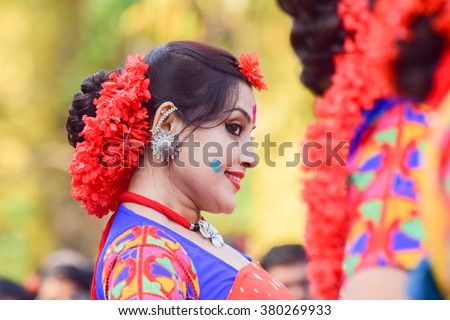 KOLKATA , INDIA - MARCH 5, 2015 : Young girl dancer's joyful expression at Holi / Spring festival,known as Dol (in Bengali) or Holi (in Hindi) celebrating arrival of Spring in India. Popular festival. - stock photo