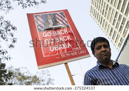 """KOLKATA - JANUARY 24:  A protester carrying """" Go Back Obama"""" sign to protest Obama's three day visit India to attend India's Republic Day parade on January 24, 2015 in Kolkata, India. - stock photo"""