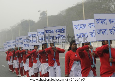 """KOLKATA-JANUARY 19 :Girls enrolled in the """"Kanyashree scheme""""- Scheme to    empower & support adolescent girls marching during the Republic Day Parade preparation on January 19, 2015 in Kolkata,India. - stock photo"""