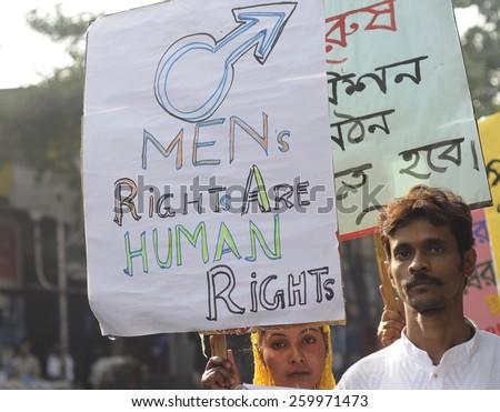KOLKATA - NOVEMBER 15 :  A man and a  muslim woman during a rally to celebrate the International Men's Day on November 15, 2014 in Kolkata, India. - stock photo