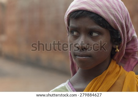 KOLKATA - OCTOBER 26 : A teenage girl - one of many girls working in brick manufacturing industry where they live and work under unhealthy and unsafe conditions on October 26, 2014 in Kolkata , India. - stock photo
