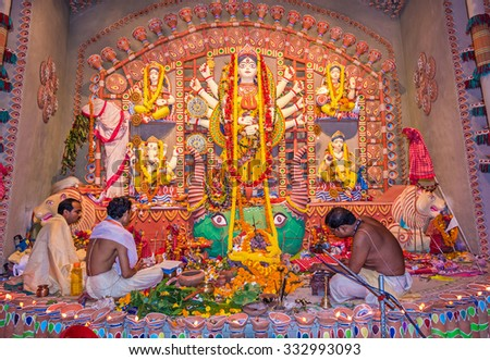 KOLKATA - OCTOBER 22: Unidentified hindu priests worship goddess Durga during the Hindu festival of Dussera on October 22, 2015 at Buroshibtala, Kolkata, India. - stock photo