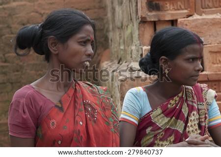 KOLKATA - OCTOBER 26: Women workers inside a brick factory on October 26,2014 in Kolkata,India. - stock photo