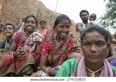 KOLKATA - OCTOBER 26 :Women workers of a brick factory in different moods while sitting in a group inside a brick factory on October 26, 2014 in Kolkata , India.  - stock photo