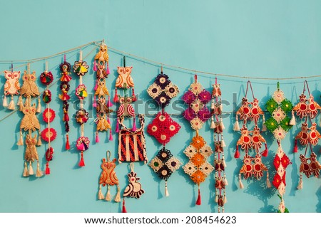 KOLKATA, WEST BENGAL , INDIA - DECEMBER 14TH 2013 : Artworks of handicraft, on display during the Handicraft Fair in Kolkata - the biggest handicrafts fair in Asia. - stock photo