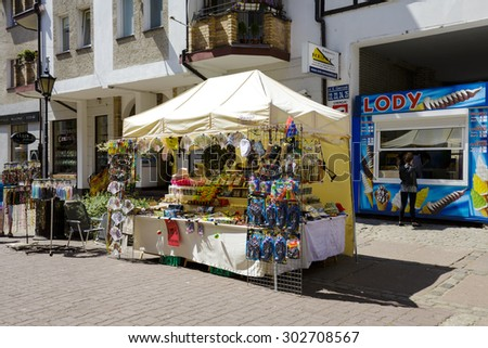 KOLOBRZEG, POLAND - JULY 14, 2015: Various souvenirs offered for sale, the stand located at the famous pedestrian street in the Old Town district, among other offers the gifts and many small stuff. - stock photo