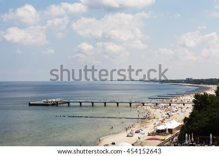 KOLOBRZEG, POLAND - JUNE 22, 2016: Unidentified sunbathers enjoying the sun on one of the widest sandy beach on the Polish coast of the Baltic Sea. - stock photo