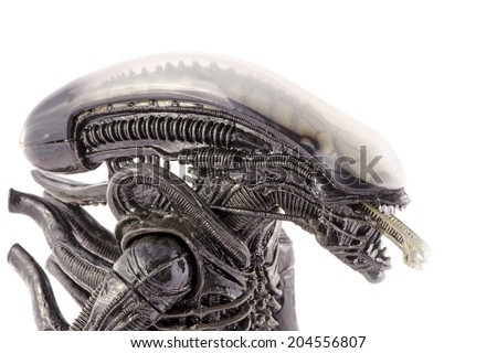 Komarom, Hungary - June 28, 2014: This is a 9 inches tall action figure by Neca Toys. This plastic model represents the monster from the original Alien movie (1979). / Alien head and inner jaws  - stock photo
