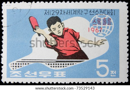KOREA - CIRCA 1967: A post stamp printed in Korea shows sportsman, series devoted the 29th World Table Tennis Championships, Pyongyang,  circa 1967. - stock photo