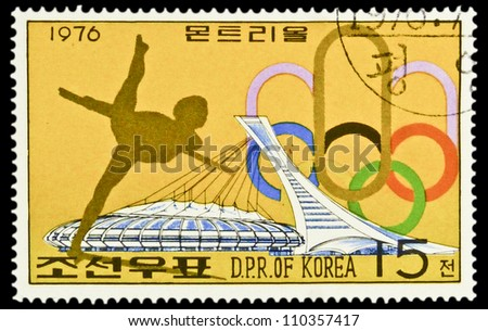 "KOREA - CIRCA 1976: stamp printed in North Korea, shows Gymnastics, emblem of Olympic games and stadium, without inscription, from the series ""Summer Olympic Games, Montreal, 1976"", circa 1976 - stock photo"