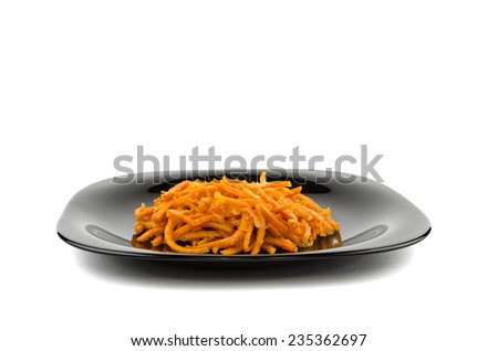 Korean carrot in a black plate - stock photo