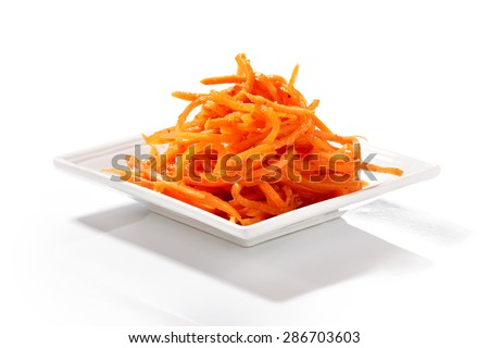 Korean carrot  in square salad plate isolated on white background  - stock photo