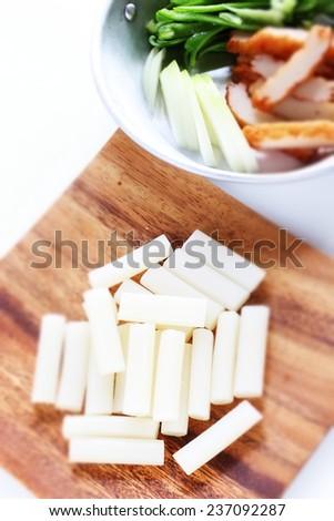 Korean food ingredient, sticky rice cake stick Garaeddeok with vegetable on background - stock photo