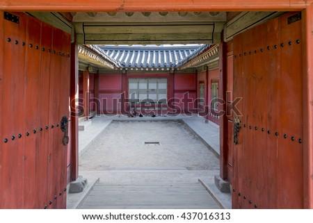 Korean traditional architecture -Korean Tradition red wooden doorin  Bukchon place in Seoul, republic of Korea / south korea - stock photo