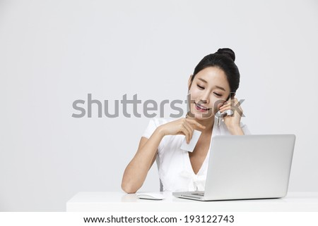 Korean woman browsing and shopping online - stock photo