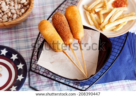korndog with french fries and ketchup in a still life - stock photo
