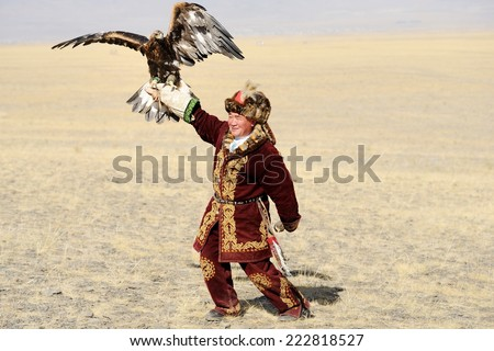 Kosh-Agach,Russia - September 21, 2014: the hunter with an eagle at the festival: Berkut-wing Chu steppe - stock photo