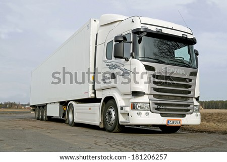KOSKI TL, FINLAND - MARCH 9, 2014: White Scania R440 truck parked. Scania sets new patent record in 2013 with over 700 invention disclosures. - stock photo