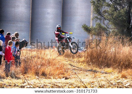 KOSTER, SOUTH AFRICA - July 11:  Africa-Offroad Racing Rally,  on July 11, 2015 at Koster, North West Province, South Africa.  HD - Motorbike ramping track during rally race.  - stock photo