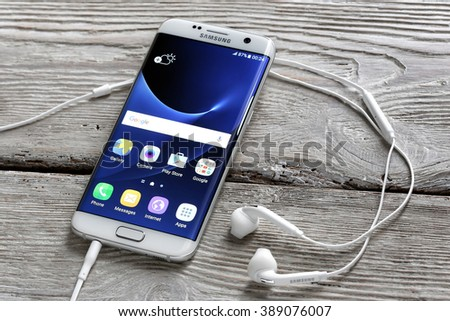 Koszalin, Poland  March 11, 2016: Photo of Samsung Galaxy S7 Edge on a table. Samsung 6 Edge are new generation smartphone from Samsung. The Samsung S7 Edge is smart phone with multi touch screen. - stock photo