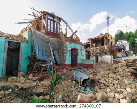 KOT DANDA, LALITPUR, NEPAL - MAY 2, 2015: Damaged house after the 7.8 earthquake that hit Nepal on April 25, 2015. - stock photo