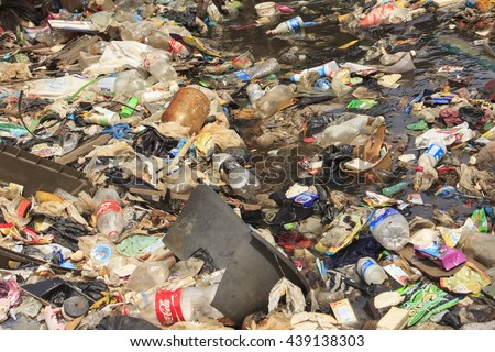 KOTA KINABALU, MALAYSIA - 05 JUNE 2016: Pollution environmental problem. Plastic bags and bottles and sewerage dumped directly into ocean due to lack of sanitation and refuse collection services. - stock photo