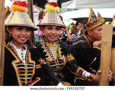 KOTA KINABALU, MALAYSIA - MAY 30 : Kadazan Papar ladies in their traditional costume poses for the public during Harvest Festival celebration May 30, 2014 in Kota Kinabalu, Sabah, Malaysia. - stock photo