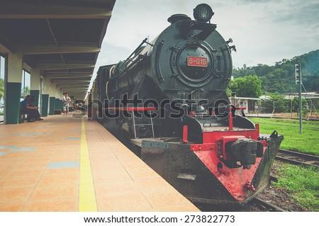 KOTA KINABALU, SABAH MALAYSIA - January 28, 2015: North Borneo Railways (NBR) Steam 6-015 locomotive  in retro styled image.NBR in Borneo is among few steam railway still in operation in the world. - stock photo