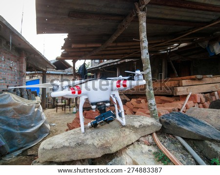 KOTDANDA, LALITPUR, NEPAL - MAY 2, 2015: A DJI Phantom 2 with a GoPro Hero3+ is used to assess the damages in the village. - stock photo