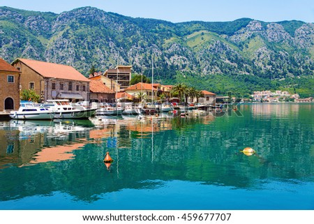 Kotor coastal town, old Mediterranean port, in secluded part of Bay of Kotor (Boka Kotorska) with yachts and fishing boats, Montenegro. Mirror Adriatic Sea surface and idyllic seascape. - stock photo