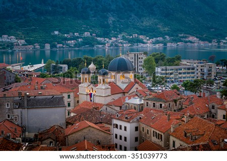 Kotor old town at night. Roman Catholic Cathedral of St Tryphon and traditional red roofs. Montenegro - stock photo