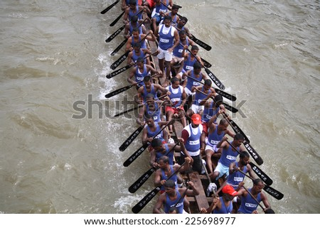 KOTTAYAM, INDIA - AUGUST 29 : A snake boat team races ahead in the Thazhathangadi Boat race held on August 29, 2010 in Kottayam, Kerala, India. - stock photo
