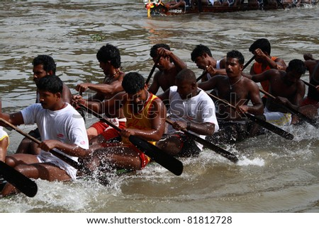 KOTTAYAM, INDIA - AUGUST 29 : Oarsmen in a snake boat team row vigorously in the Kottayam Boat race on August 29, 2010 in Kottayam, India. - stock photo