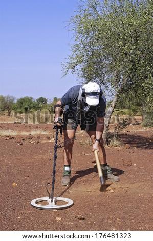 KOUPELA, BURKINA FASO - NOVEMBER 11 : a French gold prospector working in the African savannah in Burkina Faso, november 11, 2010 - stock photo