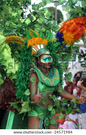 KOUROU, FRENCH GUIANA - FEBRUARY 11: this woman participates in the main carnival parade February 11, 2007 in Kourou, French Guiana. The yearly theme contest is the NATURE. - stock photo