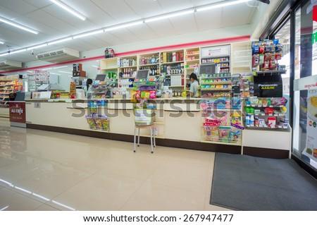 Krabi, 24 november 2014: 7-Eleven shop interior with cash desks in Ao Nang district, Krabi province, Thailand. - stock photo