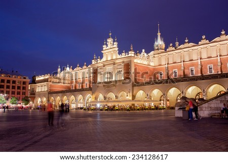 Krakow at night in Poland. Cloth Hall (Polish: Sukiennice) on the Main Market Square in the Old Town. - stock photo