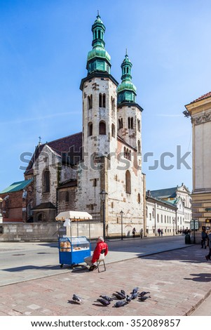 Krakow - Poland - April 22. Man is selling bagels near the St Andrew Church.. one of the oldest monuments in Krakow (1079-1098). Krakow - Poland - April 22, 2015 - stock photo