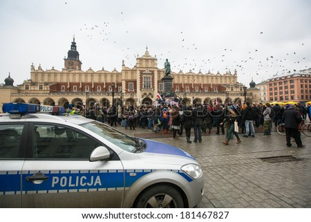 KRAKOW, POLAND - FEB 22, 2014: Unidentified participants during demonstration on Main Square, in support of Independence Ukrainein and against the killing of protesters in Kiev.  - stock photo