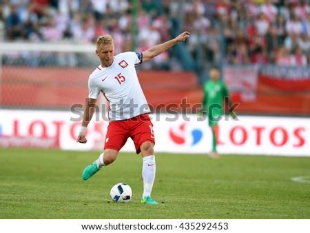 KRAKOW, POLAND - JUNE 06, 2015: EURO 2016 European International Friendly Game Poland - Lituania o/p  Kamil Glik  - stock photo