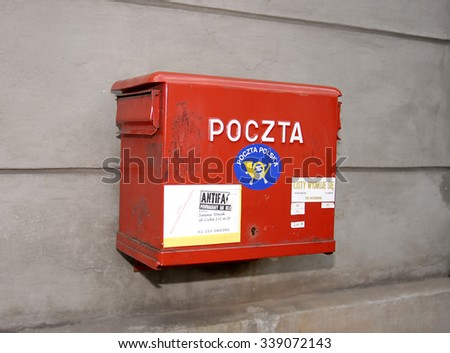 KRAKOW, POLAND - JUNE 08, 2007: Polish National Post red mailbox on the street of Krakow. Polish postal service was established in 1558 by starting permanent postal route between Krakow and Venice - stock photo
