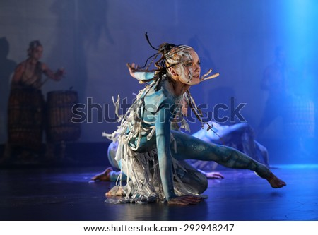 KRAKOW, POLAND - JUNE 20, 2014: The night of the Music on Szczepanski Square in Cracow. Slavic Prelude perfomed by WATAHA  Slavic Drummers and Art Color Ballet shows the Slavic world, full of magic - stock photo