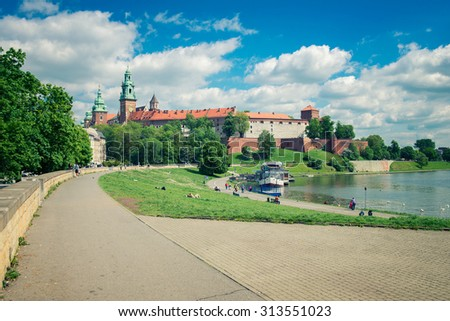 KRAKOW, POLAND - MAY 11, 2015: People rest at Wawel Castle near the river. May 11, 2015. Krakow, Poland. - stock photo