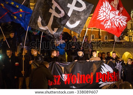 KRAKOW, POLAND - NOV 11, 2015: Nationalists protest in center of Krakow. About 3.000 people took part in March of Free Poland. Participants chanted slogans Neither EU nor NATO, Poland only for Poles. - stock photo