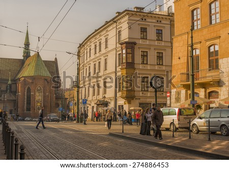 KRAKOW, POLAND - NOV 04, 2014: View of The Church of St. Francis of Assisi with Monastery of the Franciscan Order.  Architecture and streets of the old city.  Picture taken while traveling in Poland. - stock photo