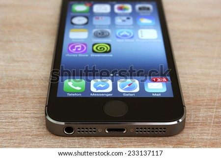KRAKOW, POLAND - NOVEMBER 25, 2014: home screen page on apple iphone 5s most famous smartphone in the world. - stock photo