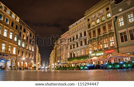 KRAKOW, POLAND - OCT 8: St. Market Square in historical center of Krakow, October 8, 2012 in Krakow, Poland. This year the city was visited by 8.1 million tourists. - stock photo